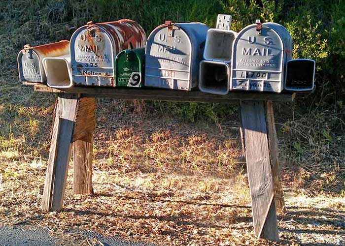 Rusted rural mailboxes near Patrick Mountain Brand Marketing.